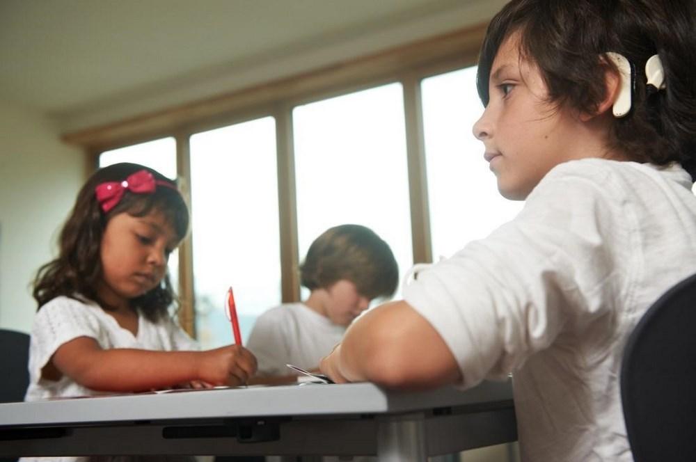 Ребенок с КИ на занятиях